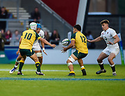 Australia fly-half Mack Mason offloads to centre Sione Tuipolotu during the World Rugby U20 Championship  match England U20 -V- Australia U20 at The AJ Bell Stadium, Salford, Greater Manchester, England on June  15  2016, (Steve Flynn/Image of Sport)