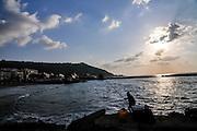 Fishing in the Mediterranean Sea, at dusk Haifa, Israel