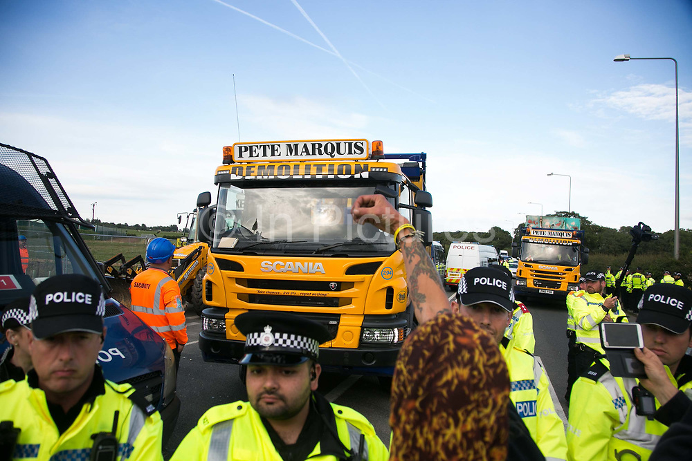 12 local activists locked themselves in specially made arm tubes to block the entrance to Quadrillas drill site in New Preston Road, July 03 2017, Lancashire, United Kingdom. Pete Marquis and his men demolish a tower erected by activists. Pete Marquis, a pro-fracker and highly controversial local entrepeneur who owns a hauling company.The 13 activists included 3 councillors; Julie Brickles, Miranda Cox and Gina Dowding and Nick Danby, Martin Porter, Jeanette Porter,  Michelle Martin, Louise Robinson,<br /> Alana McCullough, Nick Sheldrick, Cath Robinson, Barbara Cookson, Dan Huxley-Blyth. The blockade is a repsonse to the emmidiate drilling for shale gas, fracking, by the fracking company Quadrilla. Lancashire voted against permitting fracking but was over ruled by the conservative central Government. All the activists have been active in the struggle against fracking for years but this is their first direct action of peacefull protesting. Fracking is a highly contested way of extracting gas, it is risky to extract and damaging to the environment and is banned in parts of Europe . Lancashire has in the past experienced earth quakes blamed on fracking.
