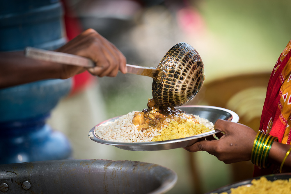"""15 September 2018, Laxmipur, Nepal: Food is served after worship. """"You are the light of the world"""" was the theme, based on Matthew 5:14, as hundreds gathered at the Nepal Evangelical Lutheran Church in Laxmipur on 15 September to worship together with ecumenical guests and visitors from the Lutheran World Federation. The Nepal Evangelical Lutheran Church was established in 1943, and celebrated its 75th anniversary on 14 September."""