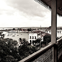 "Stone Town, Zanzibar 05 November  2010<br /> View of the port from Beit al-ajaib or ""House of Wonders"", Zanzibar's best-known historic building. Built as a ceremonial and administrative palace by Sultan Barghash in 1883. Now a National Museum. Stone Town or Mji Mkongwe, in Swahili meaning ""ancient town"", is the old part of Zanzibar City, the capital of the island of Unguja, informally known as Zanzibar, part of Tanzania. The town was the centre of trade on the East African coast between Asia and Africa before the colonization of the mainland in the late 19th century after which the focus moved to Mombasa and Dar es Salaam. From 1840 to 1856, Said bin Sultan had the capital of the Omani Empire in Stone Town. The main export was spices and particularly cloves. For many years Stone Town was a major centre for the slave trade; slaves were obtained from mainland Africa and traded with the Middle East. The town also became a base for many European explorers, particularly the Portuguese, and colonizers from the late 19th century. David Livingstone used Stone Town as his base for preparing for his final expedition in 1866. A house, now bearing his name, was lent by Sultan Seyyid Said. Immigrant communities from Oman, Persia and India lived here. <br /> Photo: Ezequiel Scagnetti"