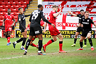 Barnsley forward Jacob Brown (33) looks to see his shot go in the back of the net in time added on during the EFL Sky Bet League 1 match between Walsall and Barnsley at the Banks's Stadium, Walsall, England on 23 March 2019.