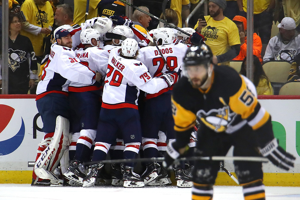PITTSBURGH, PA - MAY 07: The Washington Capitals celebrate moving on to the Eastern Conference Finals after a 2-1 overtime win behind Kris Letang #58 of the Pittsburgh Penguins in Game Six of the Eastern Conference Second Round during the 2018 NHL Stanley Cup Playoffs at PPG Paints Arena on May 7, 2018 in Pittsburgh, Pennsylvania.  (Photo by Gregory Shamus/Getty Images)