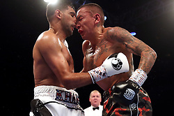 Amir Khan (left) and Samuel Vargas in action during their Welterweight contest at Arena Birmingham, Birmingham
