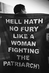 """April wore a cape reading """"HELL HATH NO FURY LIKE A WOMAN FIGHTING THE PATRIARCHY"""" on a packed train platform in the metro station after the Women's March on Washington, D.C."""