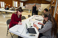 """Kassie Higgins registers as a """"first time"""" voter with Lynda Brock at the Leavitt Park Clubhouse during the NH Primary on Tuesday morning.  (Karen Bobotas/for the Laconia Daily Sun)"""