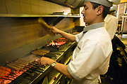 Chefs prepare kababs in Khan Chacha, a traditional but very fashionable kebab restaurant in Khan Market, New Delhi.<br /> Khan Market is a glitzy high end market frequented by the new Indian elite and foreigners. It is one of the most expensive retail streets anywhere in the world.