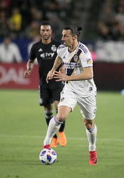 April 8, 2018 - Carson, California, U.S - Zlatan Ibrahimovic #9 of the LA Galaxy with the ball during their MLS game with the Sporting Kansas City on Sunday April 8, 2018 at the StubHub Center in Carson, California. LA Galaxy loses to Sporting, 2-0. (Credit Image: © Prensa Internacional via ZUMA Wire)