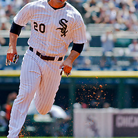 Chicago, IL - June 05, 2011:  Chicago White Sox player, Carlos Quentin (20) runs the bases against the Detroit Tigers at U.S. Cellular Field on June 5, 2011 in Chicago, IL.