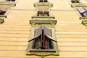 Traditional architecture and window shutters Via Cesare Battisti in Lucca, Italy