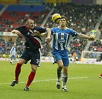 Photo: Aidan Ellis.<br /> Wigan Athletic v West Bromwich Albion. The Barclays Premiership. 15/01/2006.<br /> Wigan's Arjun De Zeuw and West Brom's Ronnie Wallwork