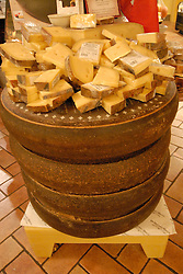 DiBruno Brothers cheese and gourmet food shop.  Cut cheese and large wheels of cheese. .Philadelphia, Pennsylvania, PA USA.  Photo copyright Lee Foster, 510-549-2202, lee@fostertravel.com, www.fostertravel.com. Photo 320-30680