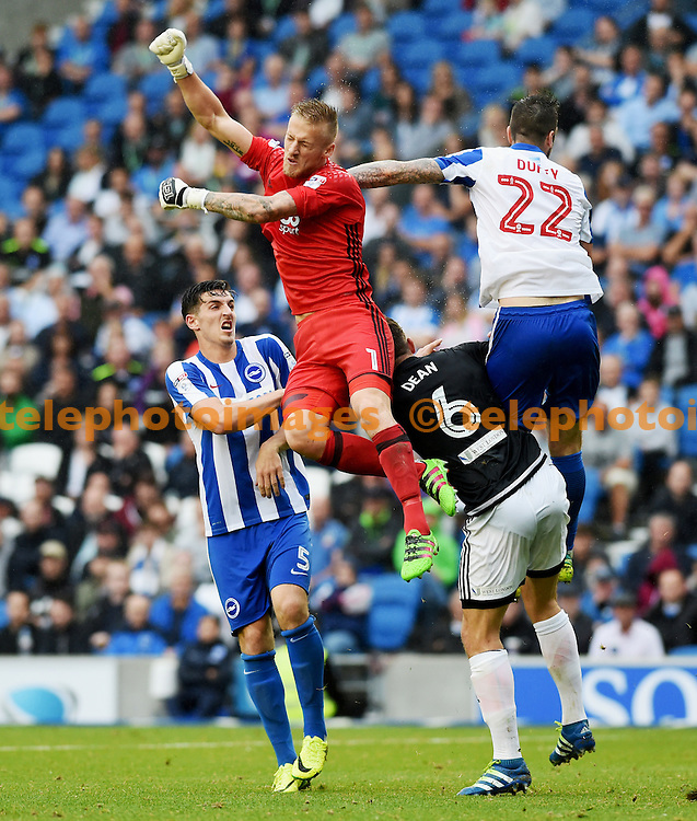 Daniel Bentley of Brentford punches the ball clear during the Sky Bet Championship match between Brighton and Hove Albion and Brentford at the American Express Community Stadium in Brighton and Hove. September 10, 2016.<br /> Simon  Dack / Telephoto Images<br /> +44 7967 642437