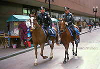 Mounted policemen on duty in Downtown Boston, Massachusetts, USA. 19880505BOS5..Copyright Image from Victor Patterson, 54 Dorchester Park, Belfast, UK, BT9 6RJ..Tel: +44 28 9066 1296.Mob: +44 7802 353836.Voicemail +44 20 8816 7153.Skype: victorpattersonbelfast.Email: victorpatterson@me.com.Email: victorpatterson@ireland.com (back-up)..IMPORTANT: If you wish to use this image or any other of my images please go to www.victorpatterson.com and click on the Terms & Conditions. Then contact me by email or phone with the reference number(s) of the image(s) concerned.