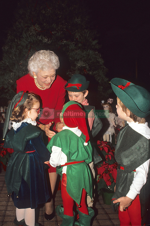 April 6, 2012 - Washington, District of Columbia, United States of America - Washington, DC. Dec. 1990.First Lady Barbara Bush plays Santa's helper with her gradchildren at the White House during the Christmas season. .Barbara Pierce Bush (born June 8, 1925) is the wife of the 41st President of the United States, George H. W. Bush, and served as First Lady of the United States from 1989 to 1993. She is the mother of the 43rd President, George W. Bush and of the 43rd Governor of Florida, Jeb Bush. Previously she had served as Second Lady of the United States from 1981 to 1989..Barbara Pierce was born in New York, New York, attended Rye Country Day School from 1931 to 1937, and is an alumna of Ashley Hall School in Charleston, South Carolina. She met George Herbert Walker Bush at age 16, and the two married in 1945, while he was on leave during his deployment as a Naval officer in World War II. They would have six children together. The Bush family soon moved to Midland, Texas; as George Bush entered political life, Barbara raised their children..As wife of the Vice President and then President, Barbara Bush has supported and worked to advance the cause of universal literacy. She founded the Barbara Bush Foundation for Family Literacy while First Lady. Since leaving the White House, she has continued to advance this cause..Credit: Mark Reinstein (Credit Image: © Mark Reinstein via ZUMA Wire)