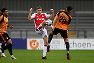Paul Mullin (10) of Wrexham and Sam Woods (28) of Barnet battles for possession during the National League match between Barnet and Wrexham FC at the Hive, Barnet, United Kingdom on 23 October 2021.
