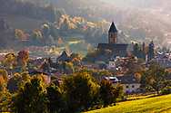 Small italian town with a big church in the Alps