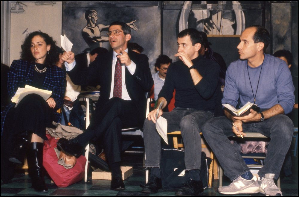 On October 19, 1989 ACT UP NY hosted an historic three hour meeting with Anthony Fauci, the then Director of the National Institute of Allergy and Infectious Diseases (NIAID), at The Gay and Lesbian Community Center (The Center) in New York City. The audience was allowed to ask Fauci questions related to HIV disease progression, treatment, community-based drug trials and allegations of homophobia in relation to Community Research Initiative funding. <br /> <br /> Front row (L-R): Peggy Hamburg, Anthony Fauci and Richard Elovich, Charlie Franchino