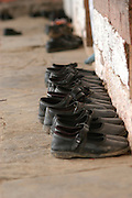India, Nagar, Kullu District, Himachal Pradesh, Northern India, A school in Nagar, the shoes are left near the wall during class