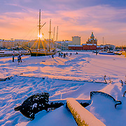 It was Saturday morning when I had a short trip around Helsinki city with amazing sunrise and temperature of -18. I saw these guys were playing ice hockey on the frozen sea.