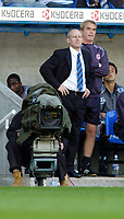 Photo: Leigh Quinnell.<br /> Reading v Sheffield United. Coca Cola Championship.<br /> 01/10/2005. Reading boss Steve Coppell watches behind a TV camera.