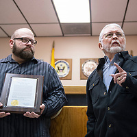 Casey Franchot, left, is presented with a citizen commendation life saving award by Jackie McKinney, mayor of Gallup, Wednesday, Jan. 23 at the Gallup Police Department for his actions Dec. 8 at the Zia Motel.