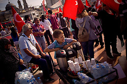 © London News Pictures. 06/06/2013 . Istanbul, Turkey.  A boy sells tea in the middle of several protesters.  After several days of hard altercations Taksim Square in Istanbul has lived a quiet day with camping and claims against the government.. Photo credit: Jordi Boixareu/LNP