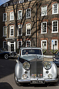 A 1954 Rolls-Royce Silver Dawn drives away from Smith Square, a small square behind the Houses of Parliament, before collecting its VIP passengers - barristers who are being sworn in as QCs aka Silks in legal vernacular, on 11th March 2019, in London, England.