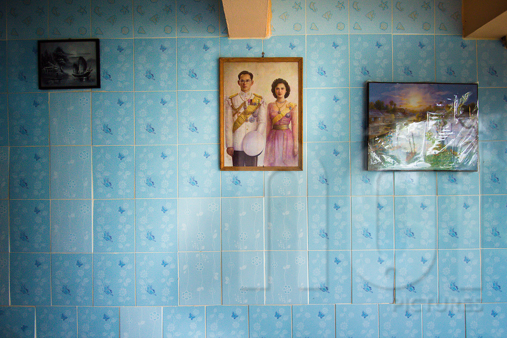 Portrait of Thailand's King and Queen hangs on the tiled wall of a guesthouse, Bangkok, Southeast Asia