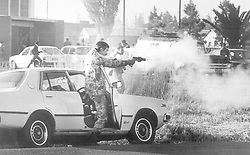 June 16 Commemorations - June 16 1981 - A policeman firing a tear gas pistol during disturbances at Regina Mundi in Soweto. Picture: Mark Peters/African News Agency(ANA)