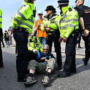 Activists arrested at Waterloo Bridge in demand the UK Govt to act of Climate Change by 2025 on 18 April 2019, London, UK.