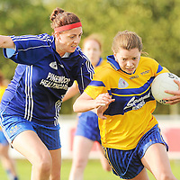 24 September 2011; Niamh O'Dea, Banner Ladies, Clare, in action against Michelle Ryan, Ballymacarbry, Waterford, during the final of the Tesco All-Ireland Ladies Football Club Sevens. Naomh MearnÛg GAA Club, Portmarnock, Co. Dublin Picture credit: Pat Murphy / SPORTSFILE *** NO REPRODUCTION FEE ***
