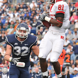 Oct 31, 2009; East Hartford, CT, USA; Rutgers wide receiver Mark Harrison (81) catches a touchdown pass during first half Big East NCAA football action between Rutgers and Connecticut at Rentschler Field.