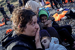 Nov. 26, 2015 - Lesbos, Greece - A group of Syrian refugees has arrived to Lesvos Island of Greece this morning. Refugees came from Turkey shores with a boat illegally. Each day some 1000 refugees are arriving on Greece's shores for almost an hour boat trip. Refugees are coming to Greece to reach Europe states. (Credit Image: © Depo Photos via ZUMA Wire)