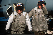 Dirty US Nacy crewmen on the deck of US Navy aircraft carrier USS Harry S Truman during its deployment patrol of the no-fly zone at an unknown location in the Persian Gulf, on 8th May 2000, in the Persian Gulf. The Truman is the largest and newest of the US Navys fleet of new generation carriers, a 97,000 ton floating city with a crew of 5,137, 650 are women.