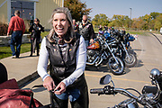 10 OCTOBER 2020 - DES MOINES, IOWA: US Senator JONI ERNST gets off her motorcycle at a campaign event. Sen. Ernst is on a ride across Iowa. She left Sioux City Saturday morning and stopped in Carroll, IA, before ending the day's ride in Des Moines at Big Barn Harley-Davidson. She had a rally in the parking lot of the Harley-Davidson dealership. The ride is a fundraiser for the Puppy Jake Foundation (which provides service animals to veterans) and the Greater Cedar Rapids Community Foundation's Derecho Disaster Recovery. About 50 people rode with Sen Ernst from Carroll to Des Moines and another 80 were waiting for her in Des Moines.     PHOTO BY JACK KURTZ