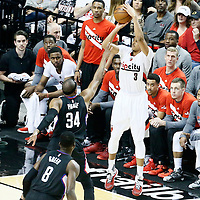 23 April 2016: Portland Trail Blazers guard C.J. McCollum (3) takes a jump shot over Los Angeles Clippers forward Paul Pierce (34) during the Portland Trail Blazers 96-88 victory over the Los Angeles Clippers, during Game Three of the Western Conference Quarterfinals of the NBA Playoffs at the Moda Center, Portland, Oregon, USA.