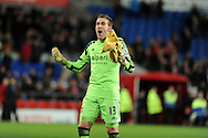 West Ham's goalkeeper Adrian celebrates his teams 2-0 win at end of match.  Barclays Premier league, Cardiff city v West Ham Utd match at the Cardiff city Stadium in Cardiff, South Wales on Saturday 11th Jan 2014.<br /> pic by Andrew Orchard, Andrew Orchard sports photography.
