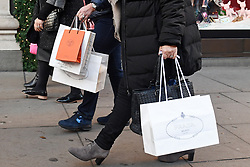 """File photo dated 04/12/16 of shoppers on Oxford Street in London. Consumer confidence is """"surprisingly stable"""" as the UK navigates the upcoming General Election and Brexit negotiations."""
