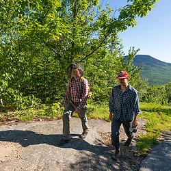 Hikers with Mount Doublehead in the distance in Jackson, New Hampshire. White Mountains.