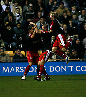 Dominic Matteo (centre) celebrates his second goal against Derby County for Stoke City