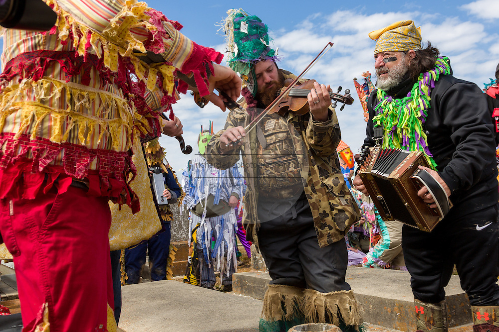 Musicians Linzay Young and Joel Savoy of the Red Stick Ramblers perform at the gravesite of legendary fiddler Dennis McGee during the Faquetigue Courir de Mardi Gras chicken run on Fat Tuesday February 17, 2015 in Eunice, Louisiana. The musicians honor the legend of McGee with a brief ceremony at his tomb yearly.