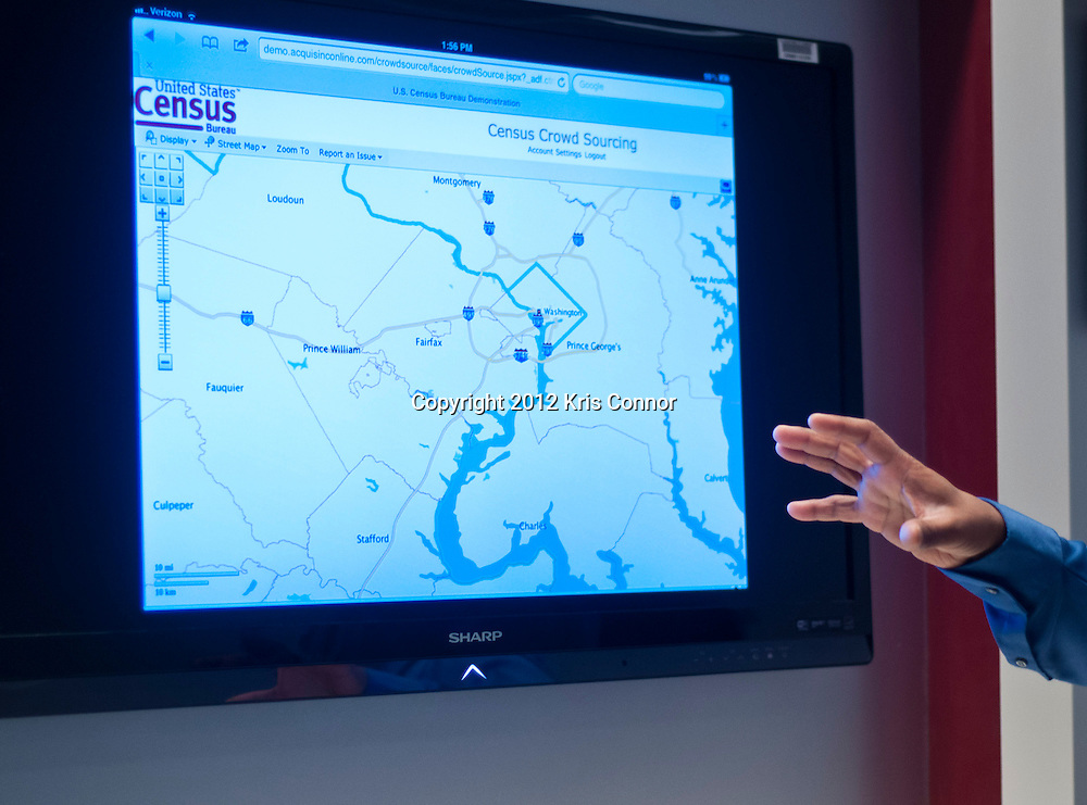 Nalin Gupta, shows how the Ipad and other mobile devices can be used to gain data for the census during a tour at the Center for Applied Technology lab at the Census Bureau headquarters in Suitland, Maryland on April 4, 2012. The bureau is looking at the Apple Ipad and other handheld devices to help get information during the 2020 census. Photo by Kris Connor