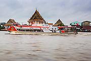 09 OCTOBER 2012 - BANGKOK, THAILAND:  A Chao Phraya Express Boat on the Chao Phraya River in Bangkok, Thailand. Chao Phraya Express boats provide a sort of bus service for people moving through Bangkok along the riverfront. .    PHOTO BY JACK KURTZ