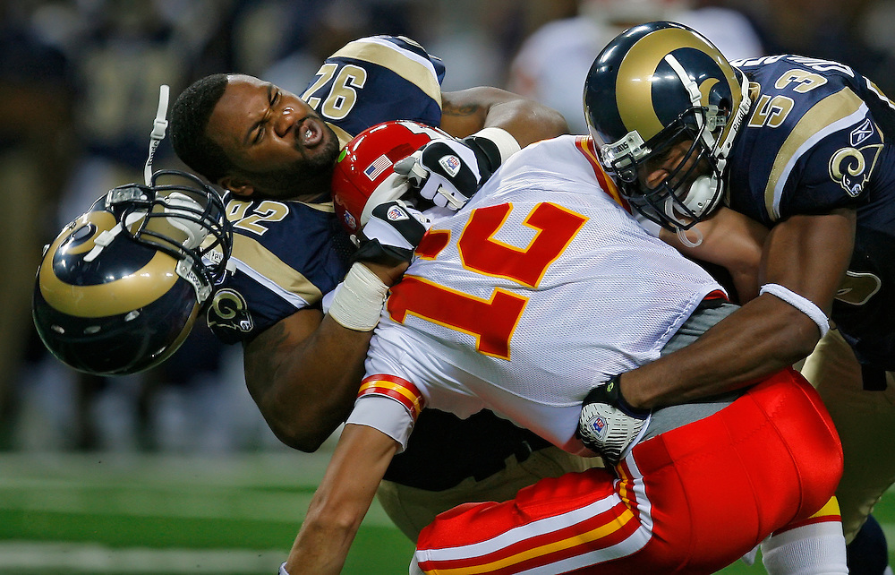 Kansas City Chiefs quarterback Brodie Croyle was sacked in the second quarter by St. Louis Rams defensive end Eric Moore, left, and Rams linebacker Chris Draft, right, in action on August 30, 2007, at the Edward Jones Dome in St. Louis, Mo.
