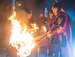 Members of Up Helly Aa' Vikings with Flaming Torches outside The Hub on Castlehill
