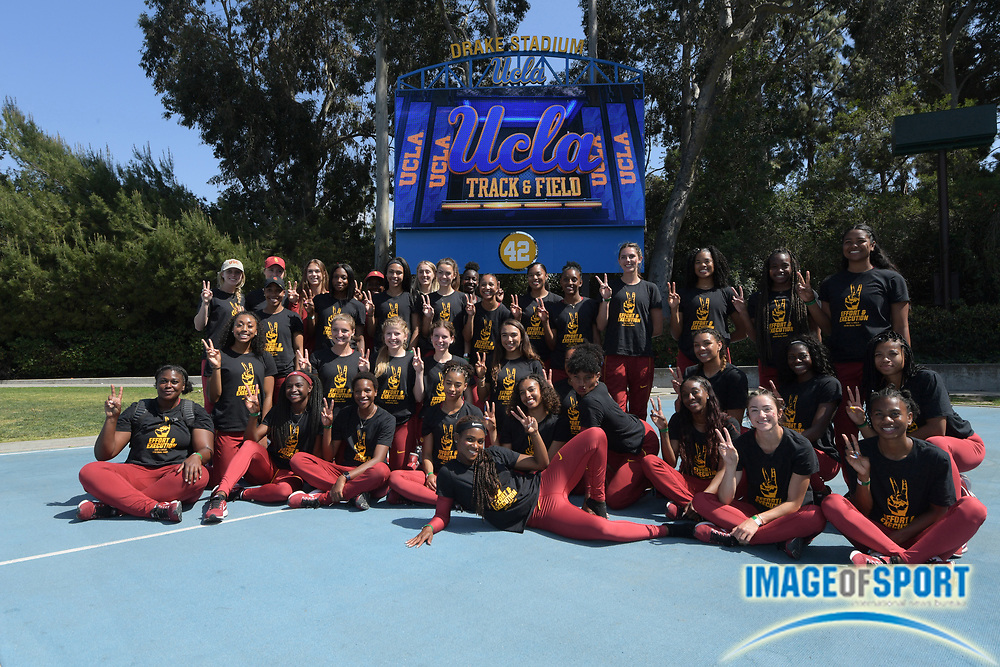 Members of the Southern California Trojans women's team pose after defeating the UCLA Bruins, 86-77, during a collegiate dual meet at Drake Stadium in Los Angeles, Sunday, April 29, 2018.