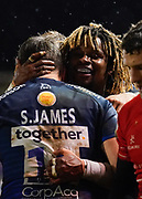Sale Sharks wing Marland Yarde celebrates with centre Sam James after scoring his 3rd try during a Gallagher Premiership Rugby Union match Sale Sharks -V- Leicester Tigers, won by Sale 36-3 Friday, Feb. 21, 2020, in Eccles, United Kingdom. (Steve Flynn/Image of Sport via AP)