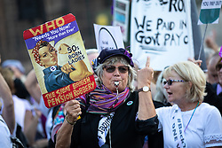 © Licensed to London News Pictures. 10/10/2018. London, UK. Women Against State Pension Inequality (WASPI) demonstrate in Parliament Square, blocking two lanes of traffic resulting in large tailbacks through Westminster. Photo credit : Tom Nicholson/LNP