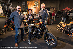 Custom Chrome Europe's Andreas Scholz and Axel Scherer as Danny Schneider unveils his latest creation he built for them at Motor Bike Expo. Verona, Italy. Friday January 19, 2018. Photography ©2018 Michael Lichter.